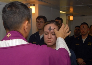 080206-N-7869M-057 Atlantic Ocean (Feb. 6, 2008) Electronics Technician 3rd Class Leila Tardieu receives the sacramental ashes during an Ash Wednesday celebration aboard the amphibious assault ship USS Wasp (LHD 1). U.S. Navy photo by Mass Communication Specialist 3rd Class Brian May (Released)