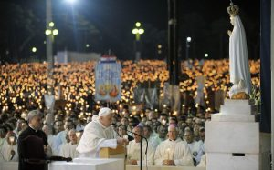 Pope benedict praying at Fatima torchlight